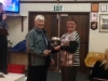 Heather George receiving the Mary Tarrant Memorial Trophy for the person contributing most to the club