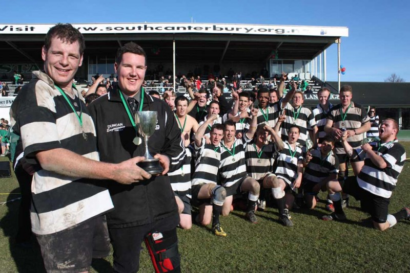 Champion side: Temuka senior B side celebrate their 28-13 Glover Cup win over Harlequins. 100-0301Magpie magic: Temuka senior B side celebrate their 28-13 Glover Cup win over Harlequins. Captain for the day Quentin Wood and injured skipper Shane Wolczuk with the silverware.